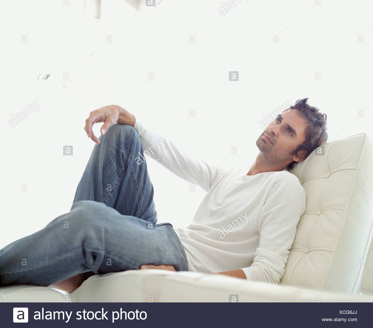 A man relaxing in a comfy seat - Stock Image
