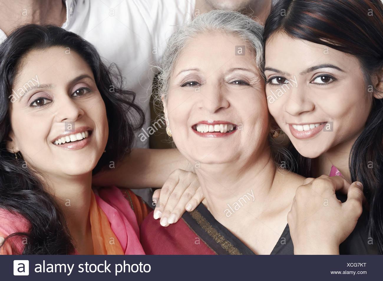 Portrait of three women smiling - Stock Image