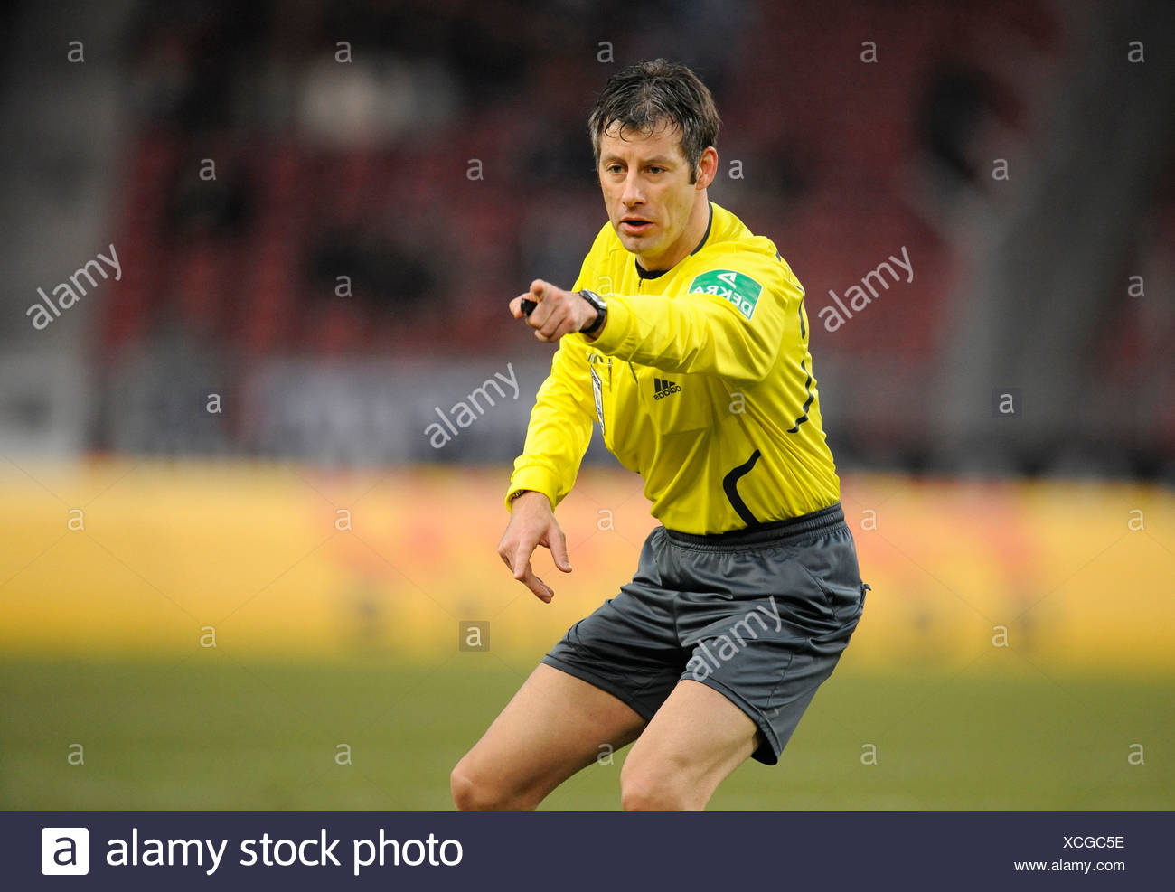 Wolfgang Stark referee indicating to continue the game Stock Photo