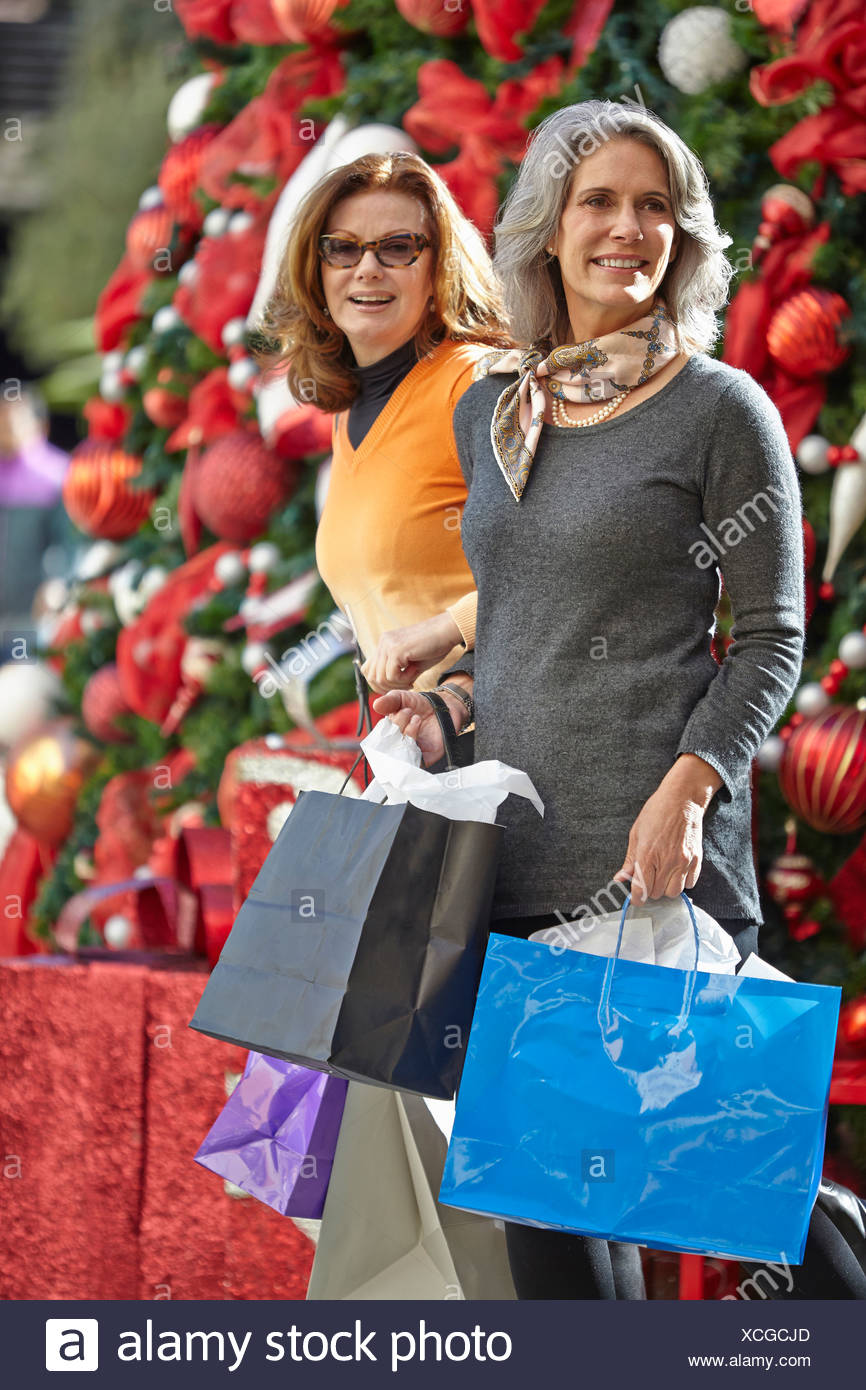 Women with Christmas shopping - Stock Image
