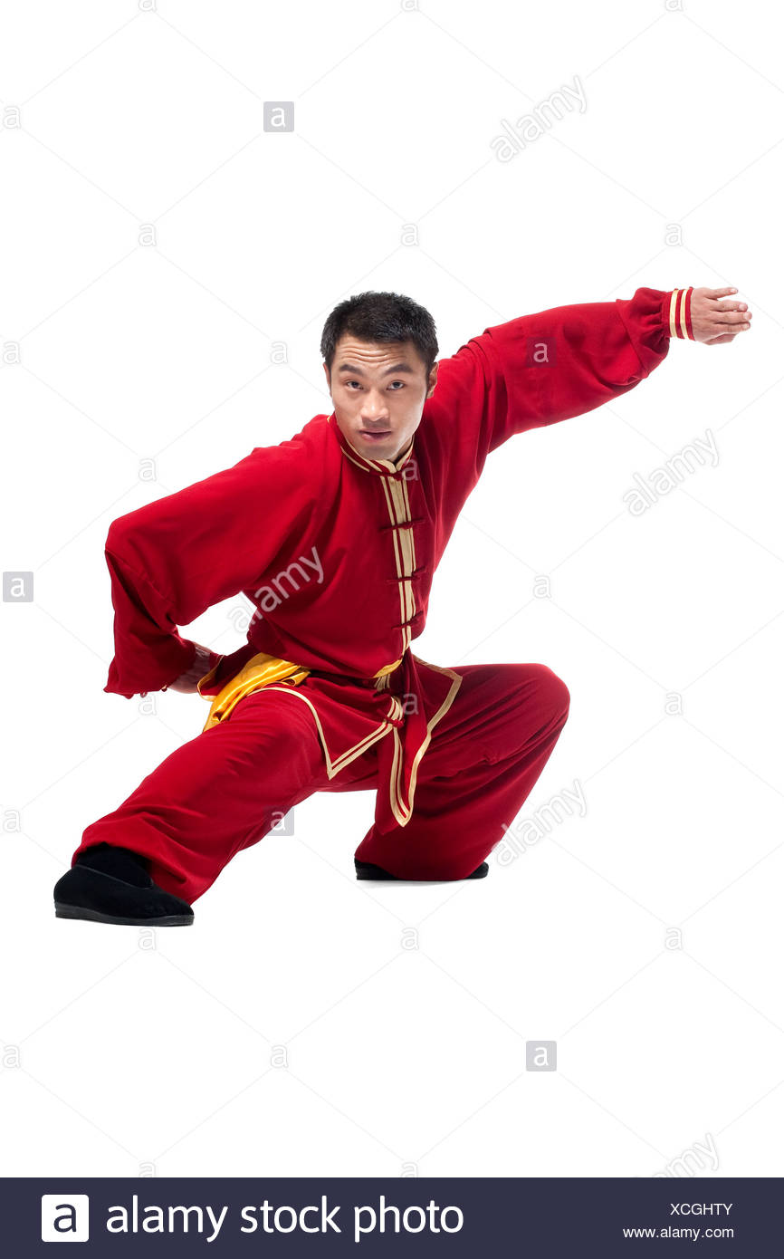 Focused Man Doing Martial Arts in Chinese Clothing Stock
