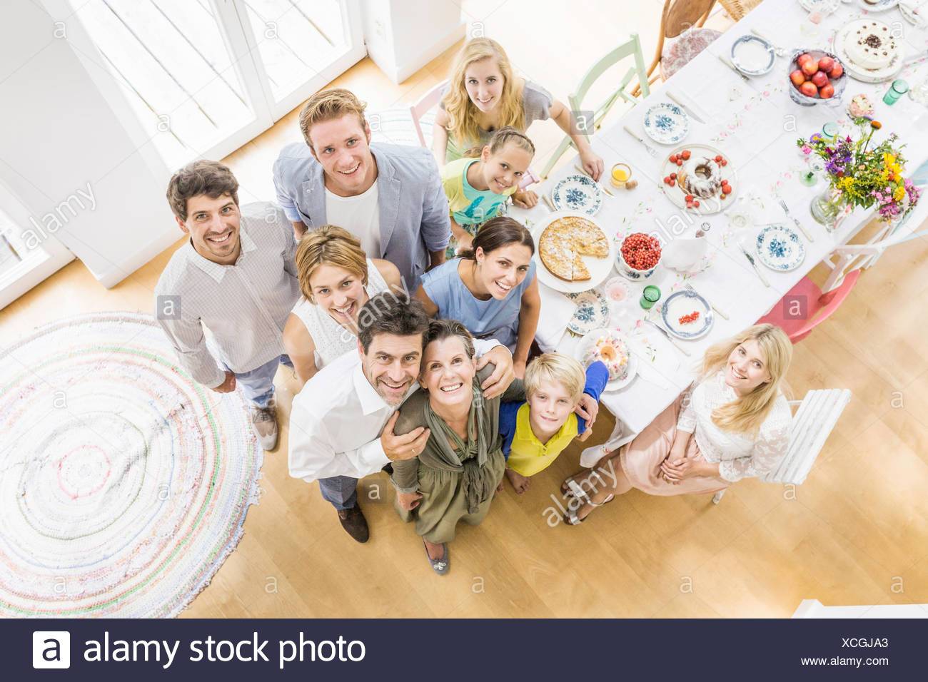 Overhead view of family in dining room at  party - Stock Image