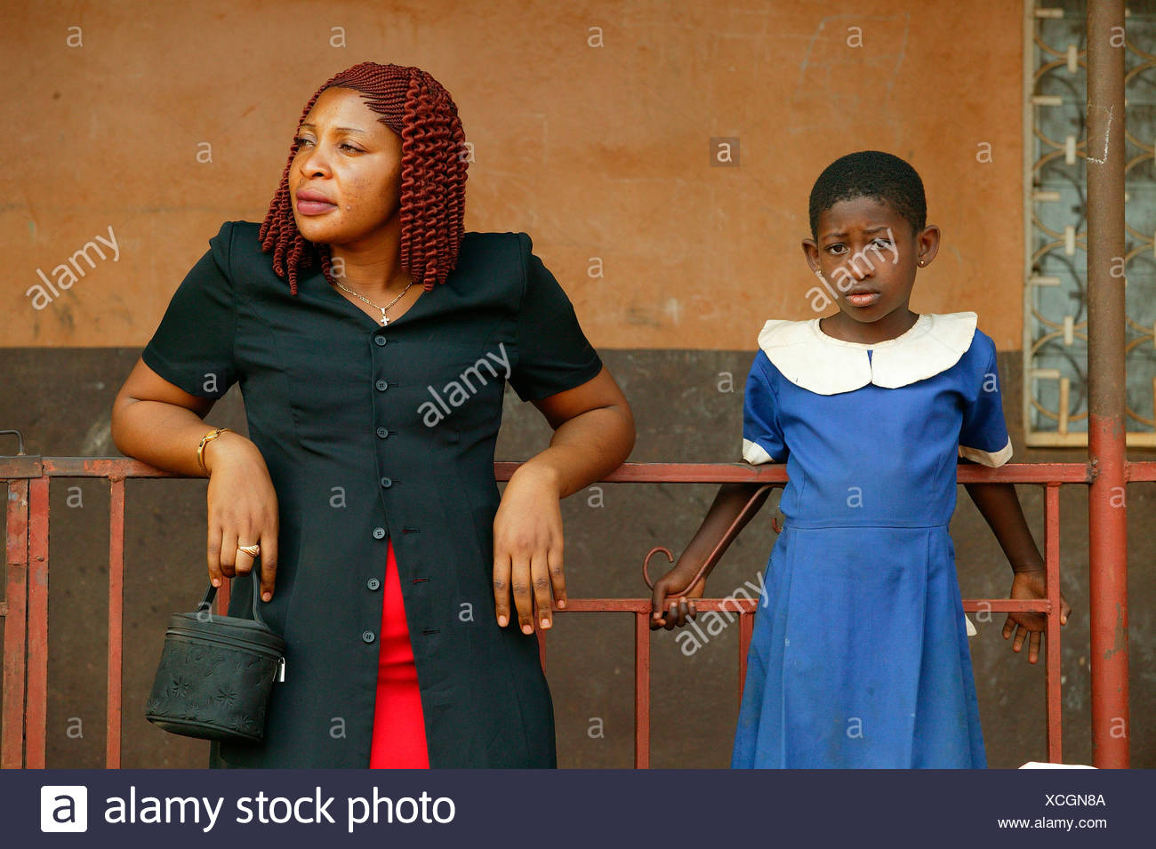 Contemporary African woman standing with a girl in a school uniform, Women's Education Centre, Bamenda, Cameroon, Africa - Stock Image
