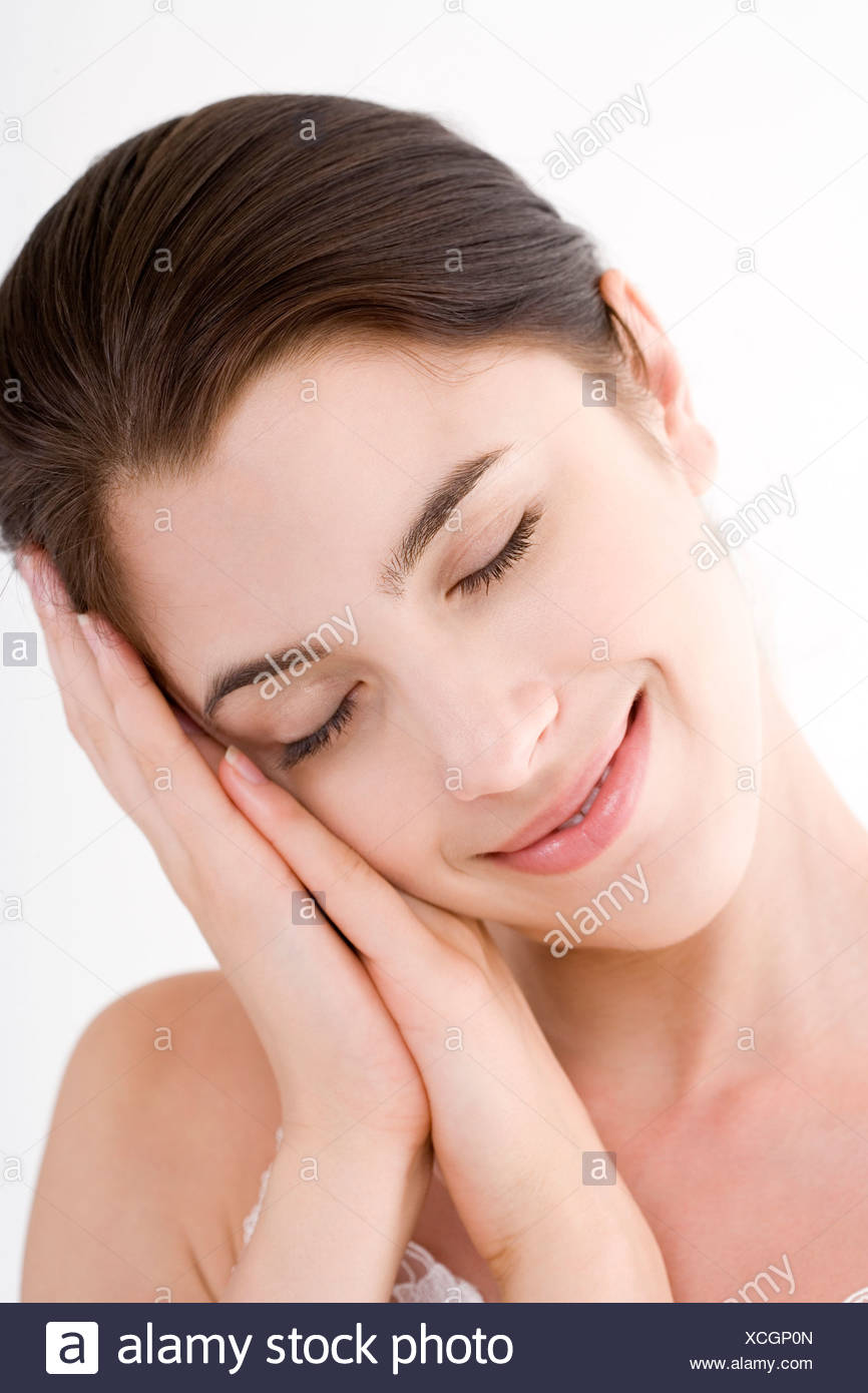 Young woman in studio head and shoulders eyes closed - Stock Image