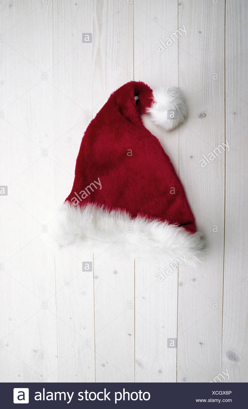 Detail view of a Santa Claus hat nailed to the wall - Stock Image