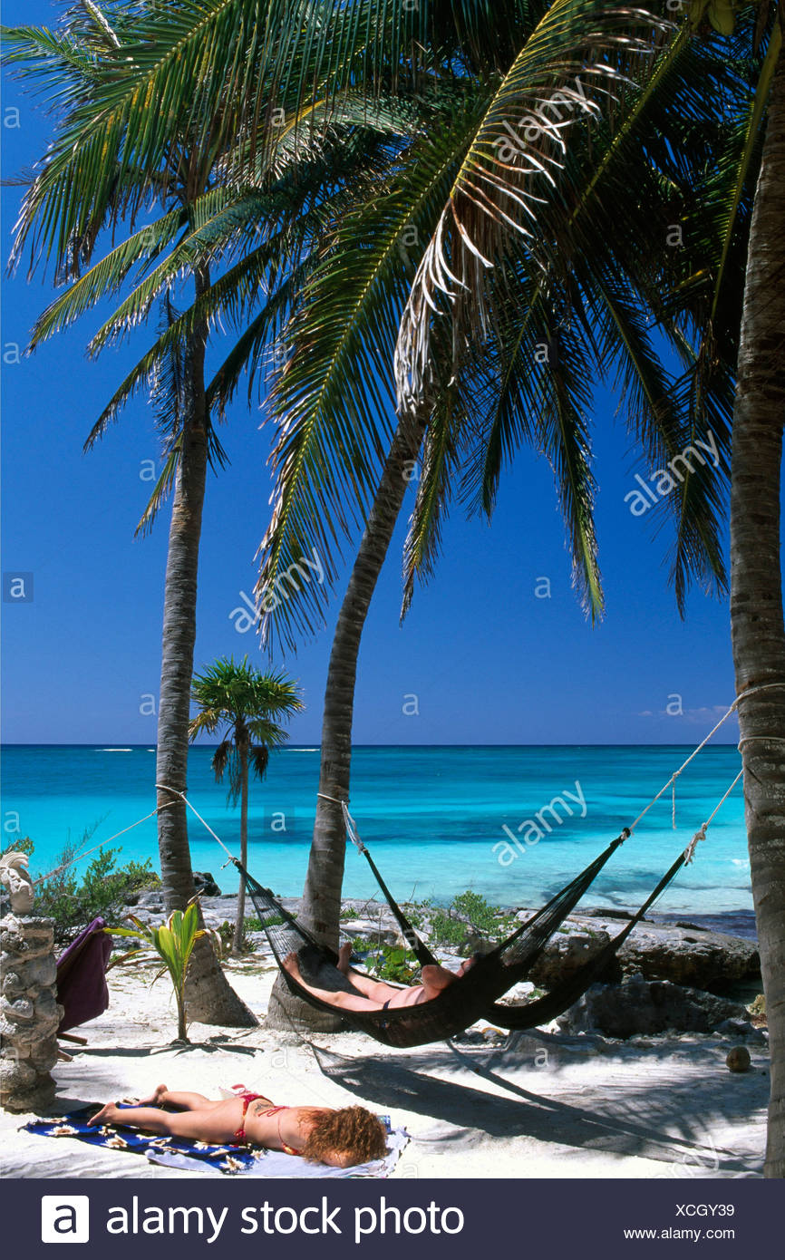 Hammocks on the Bahia de Punta Soliman Beach on the Riviera Maya River, Yucatan, Mexico, North America - Stock Image