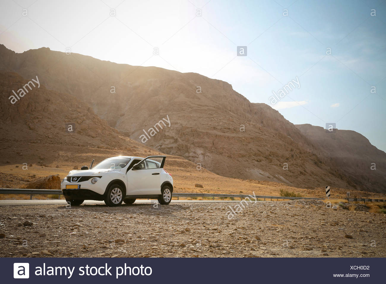 Isreal, parked car at the roadside in the desert near Dead Sea - Stock Image