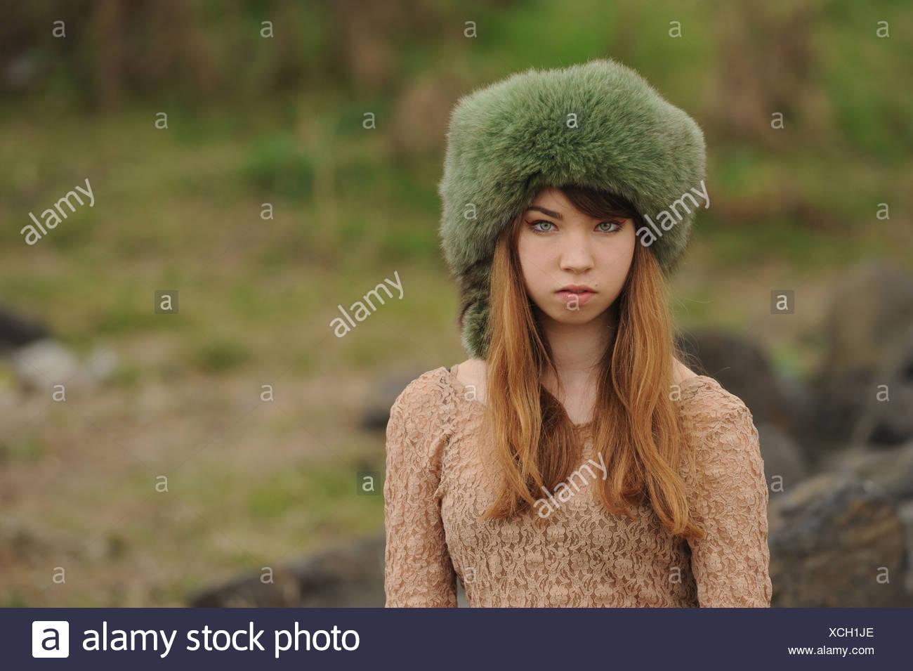Teenage girl wearing fur hat outdoors - Stock Image