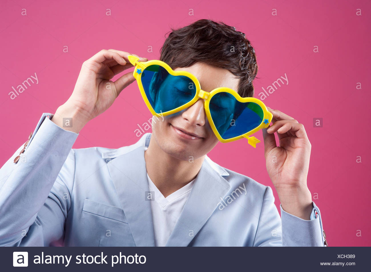 fff6aa2289cb8 A man wearing the heart shaped glasses Stock Photo  283117529 - Alamy