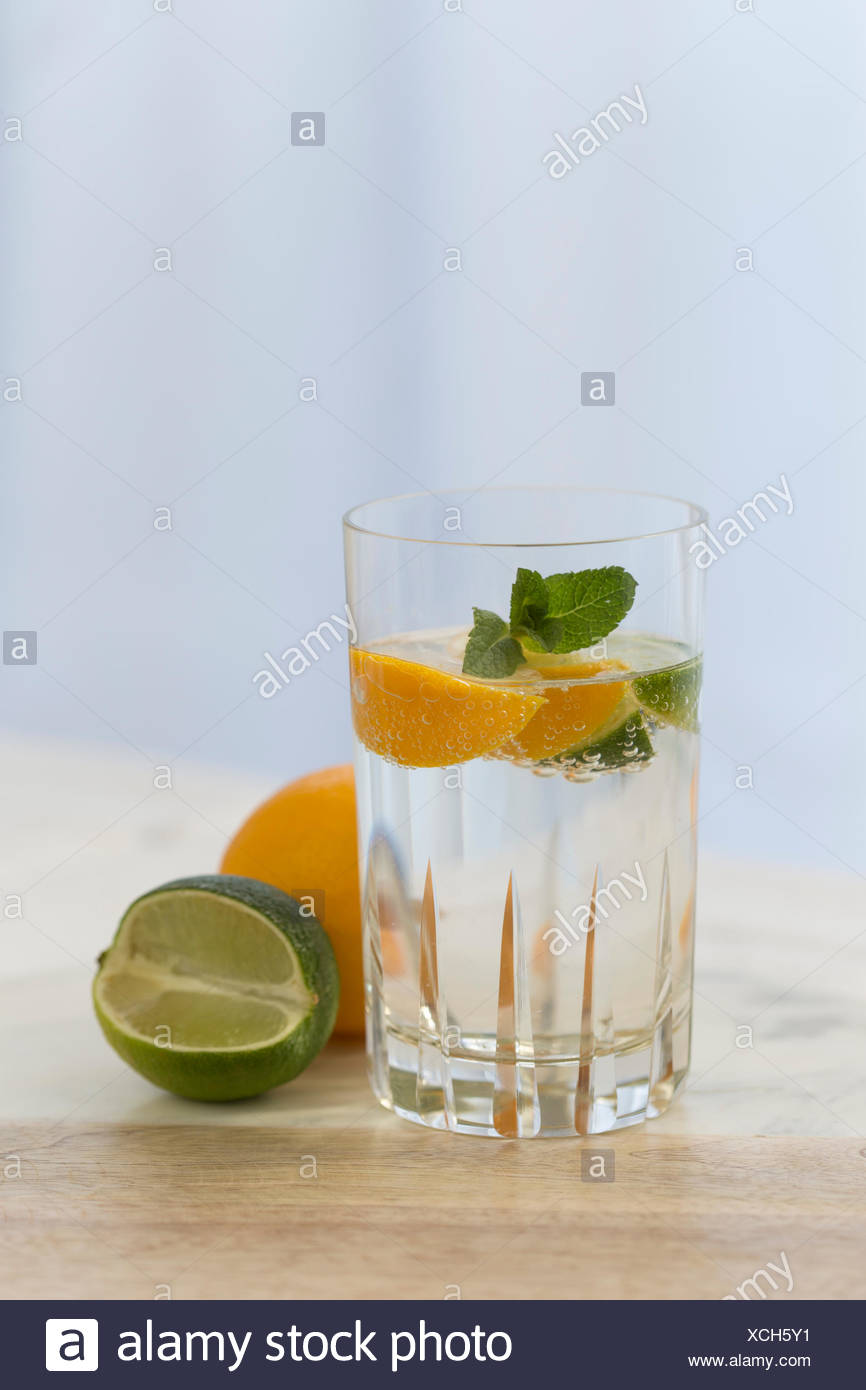 Close-Up Of Drink And Citrus Fruits On Table - Stock Image