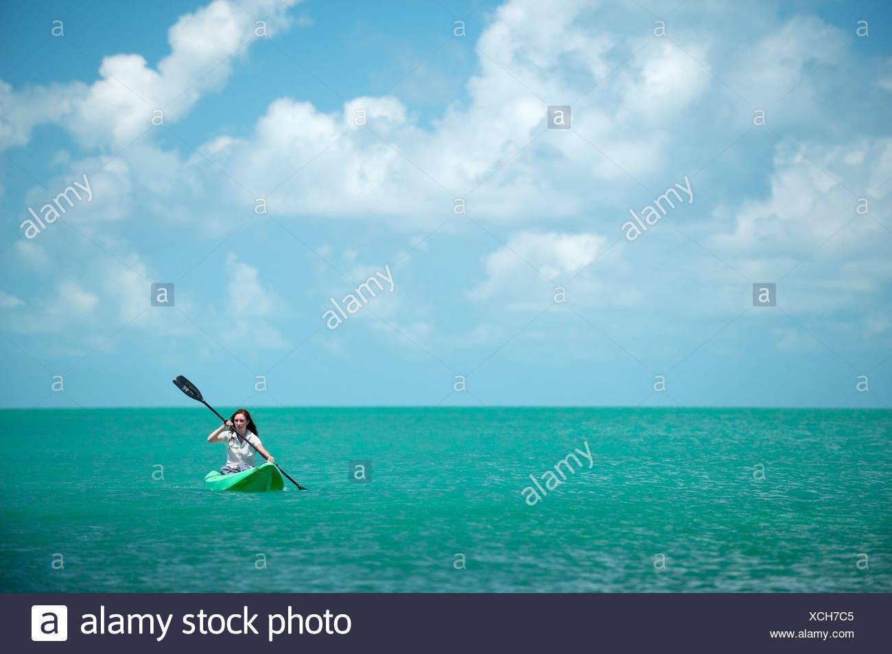 A woman kayaks in Florida. Stock Photo