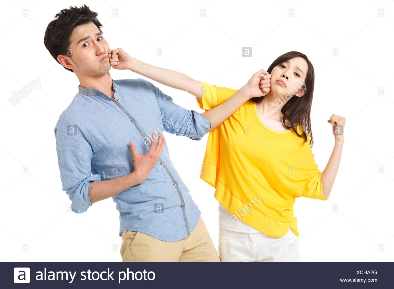 Portrait of young man and young woman - Stock Image