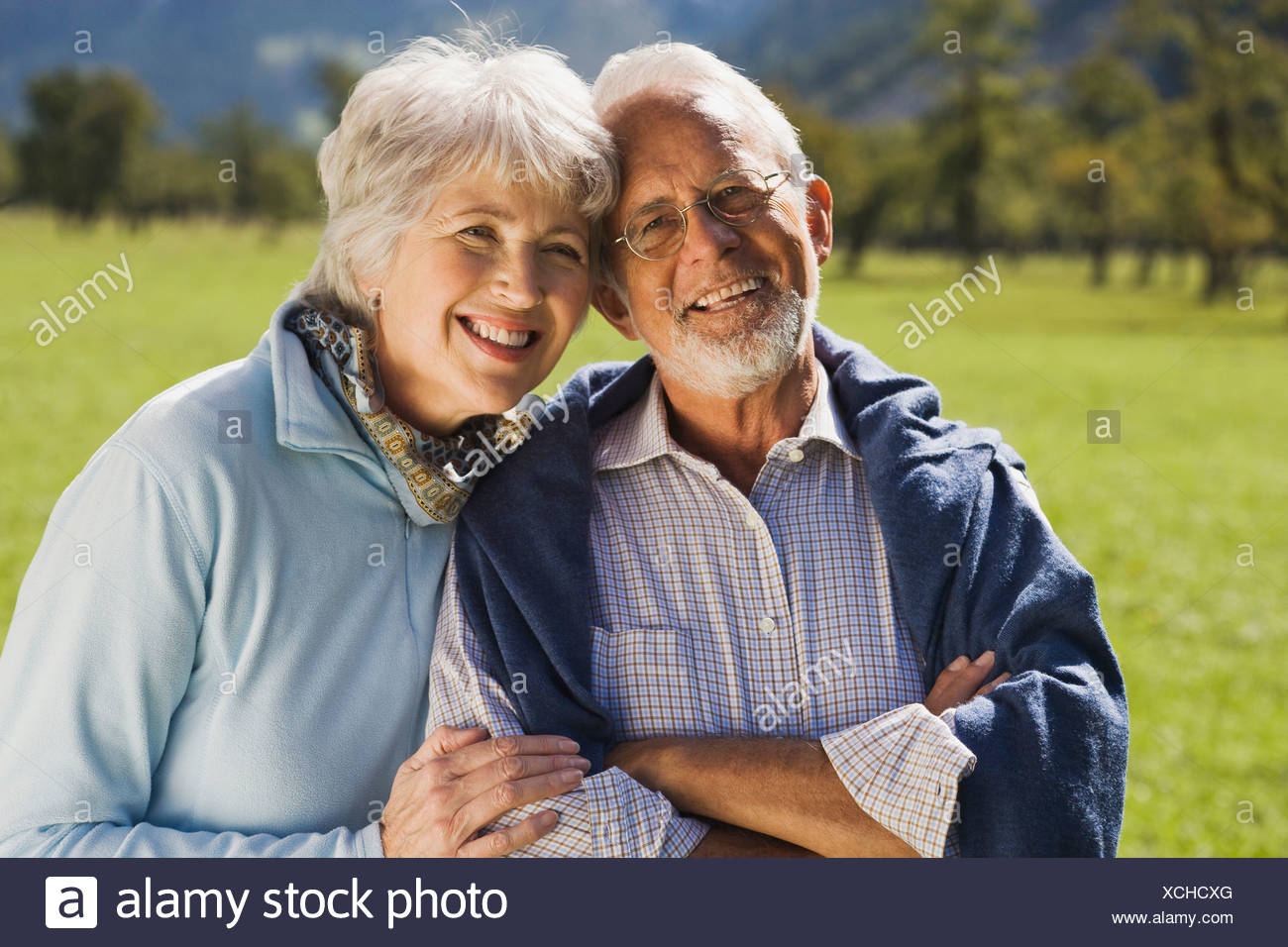 Austria, Karwendel, Ahornboden, Senior couple, smiling, portrait - Stock Image
