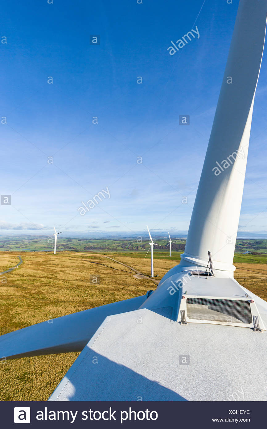 view from the top of a wind turbine nacelle showing the rotor blades. Caton Moor wind farm owned by Triodos - Stock Image