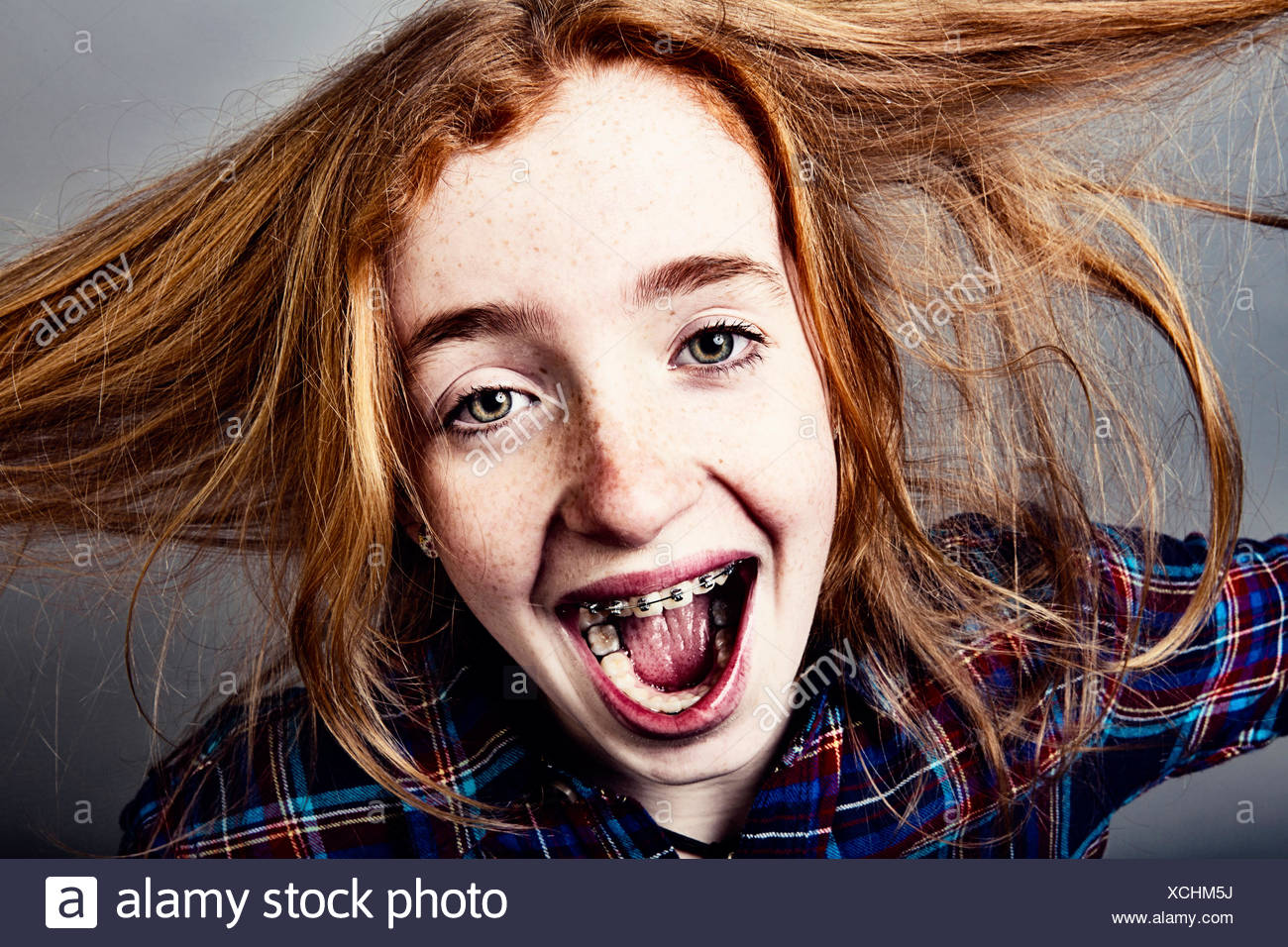 Naughty screaming red-haired girl, portrait Stock Photo