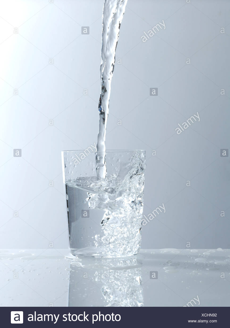 Water being poured into a glass Stock Photo
