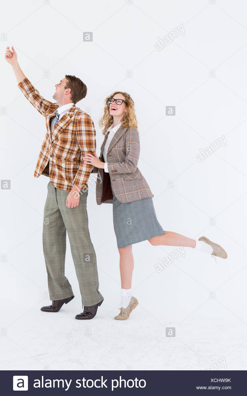 Happy geeky hipster couple - Stock Image
