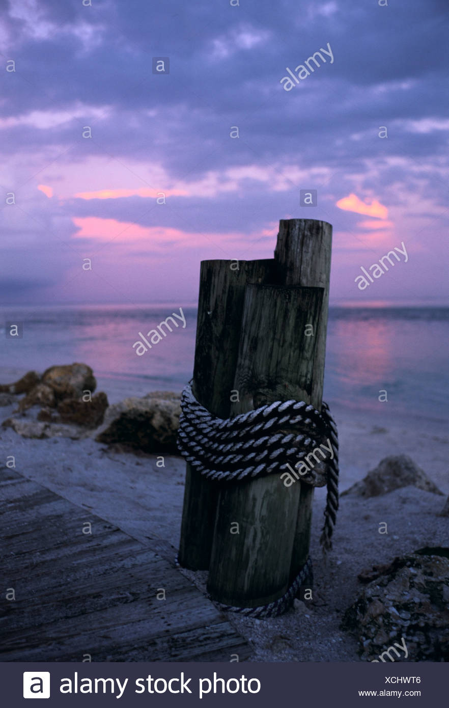 Dock posts and pier at twilight South Seas Resort Captiva Is Florida Stock Photo