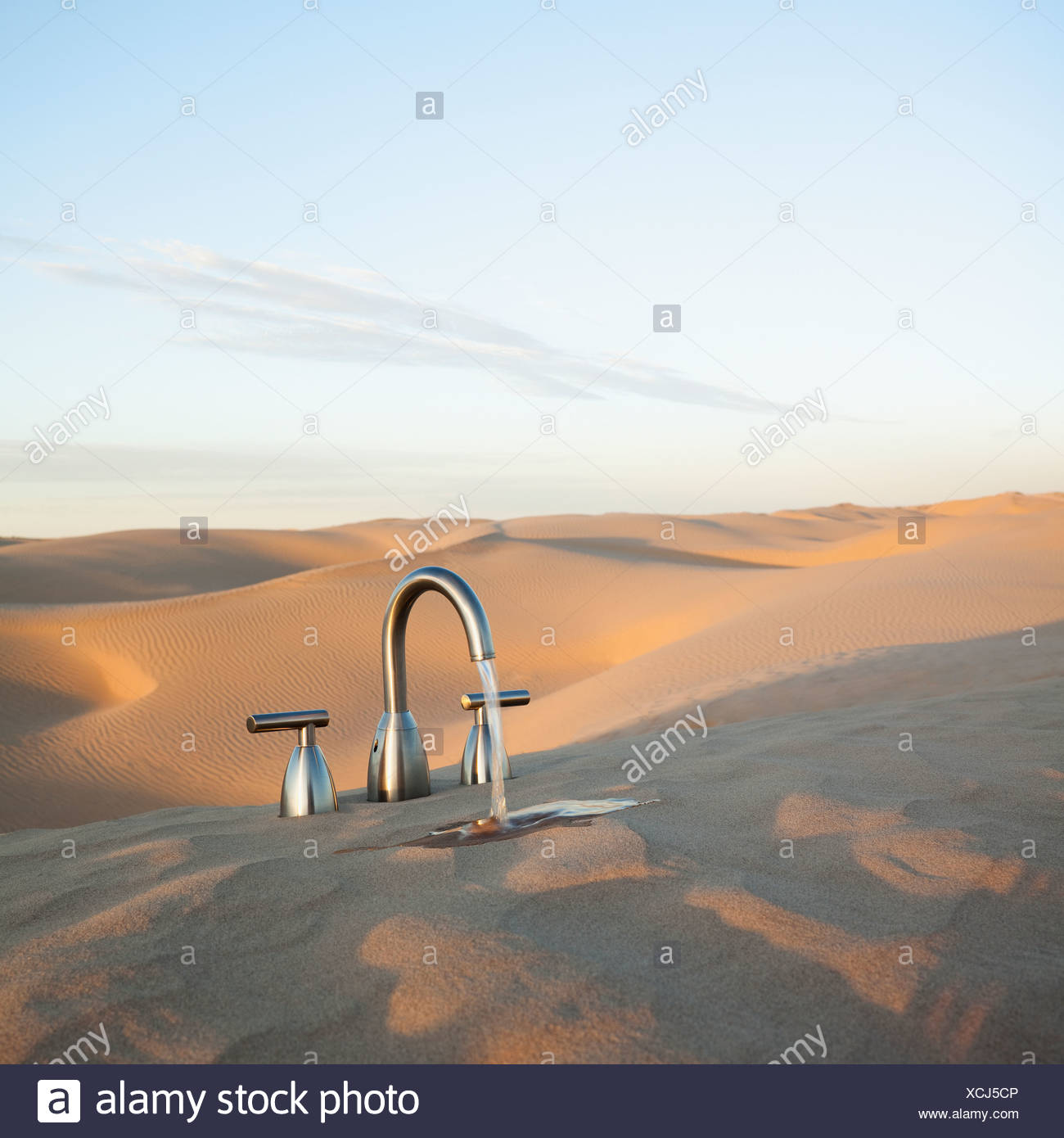 Faucet in desert - Stock Image