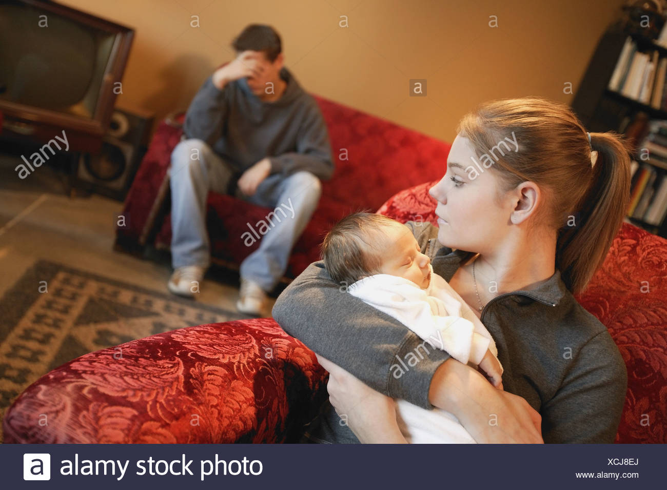 Young couple with baby - Stock Image