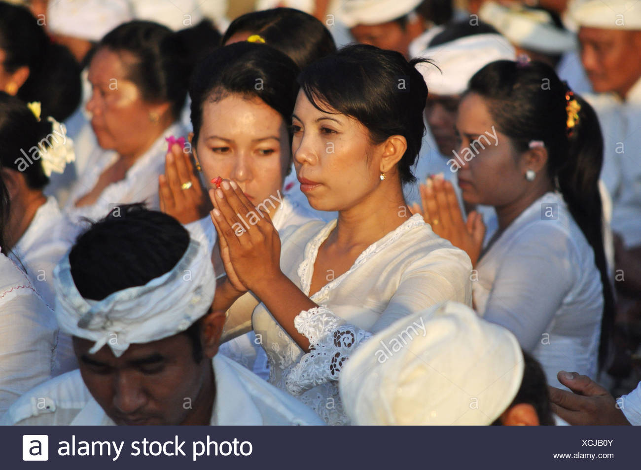 Kuta Beach Bali Indonesia People At A Collective Pray