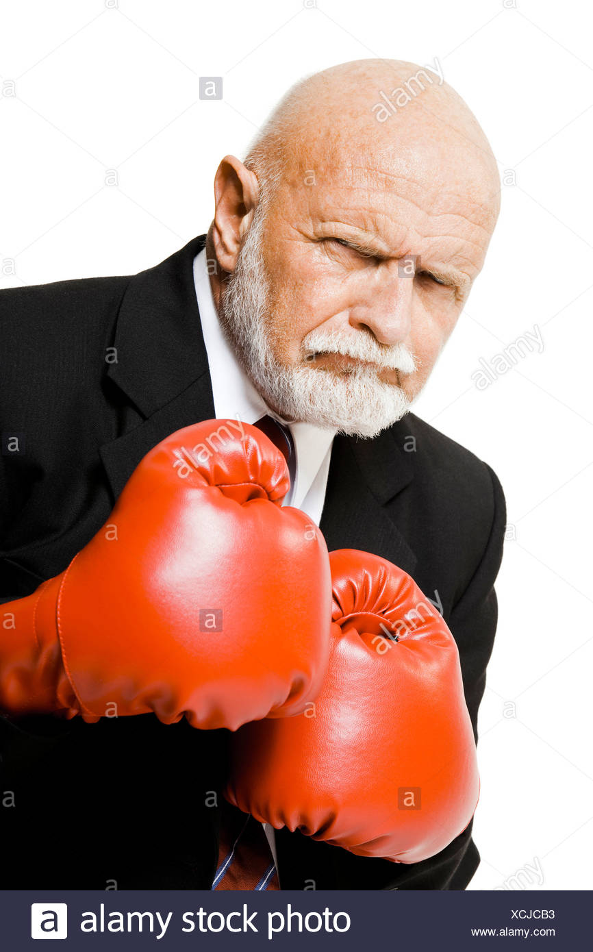 Businessman with boxing gloves - Stock Image