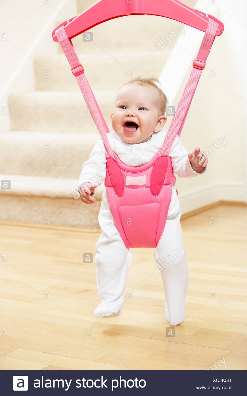 4ab06ce87 Happy Baby In Bouncer Stock Photos   Happy Baby In Bouncer Stock ...