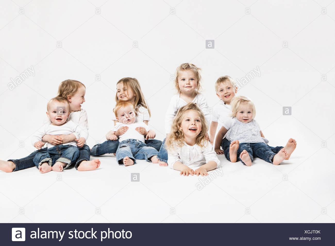 Smiling children posing together - Stock Image