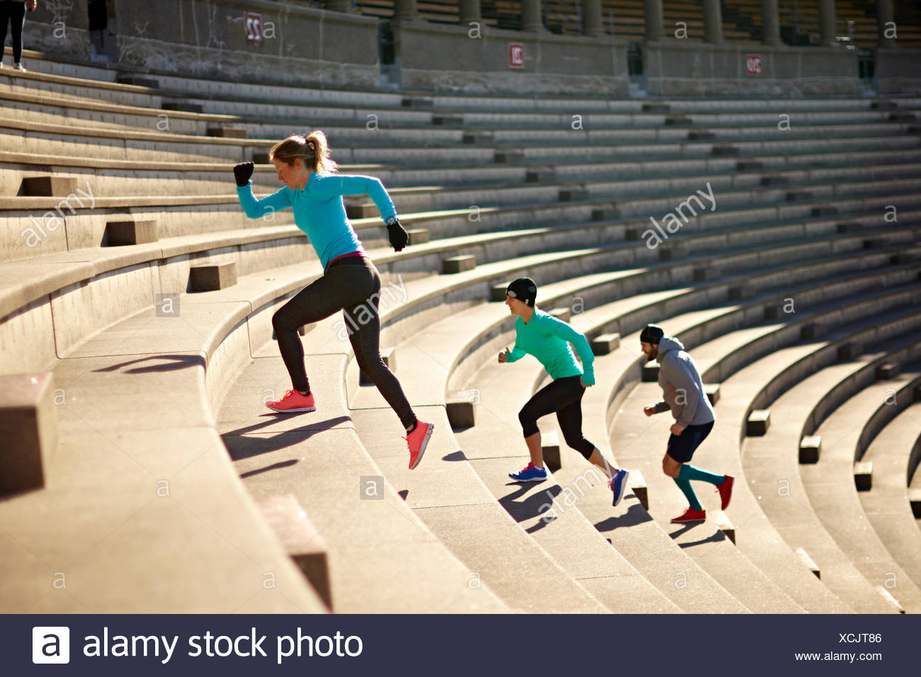 Working out on the stairs of the Harvard University Stadium - Stock Image