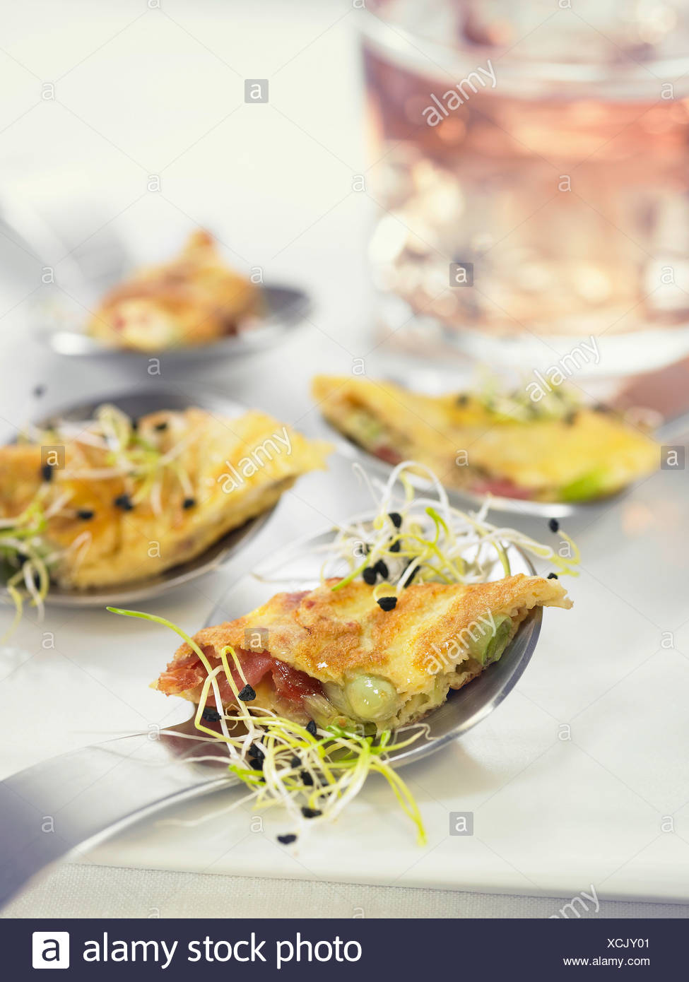Spoonfuls of spanish ham,fava bean and sprout omelette - Stock Image