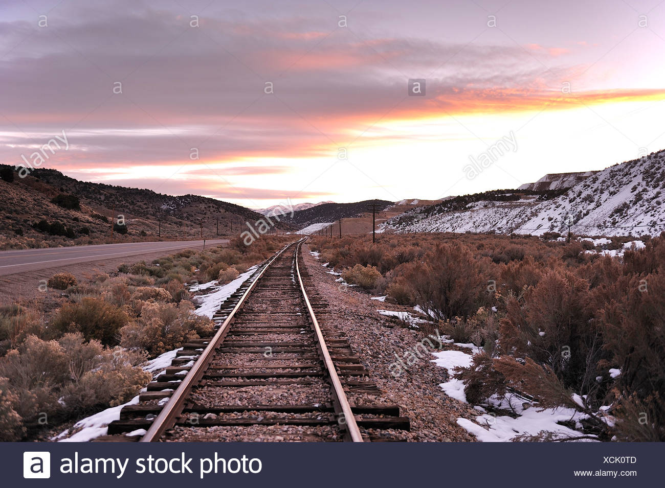 Railroad, tracks, near, Ely, loneliest road, straight, winter, USA, America - Stock Image