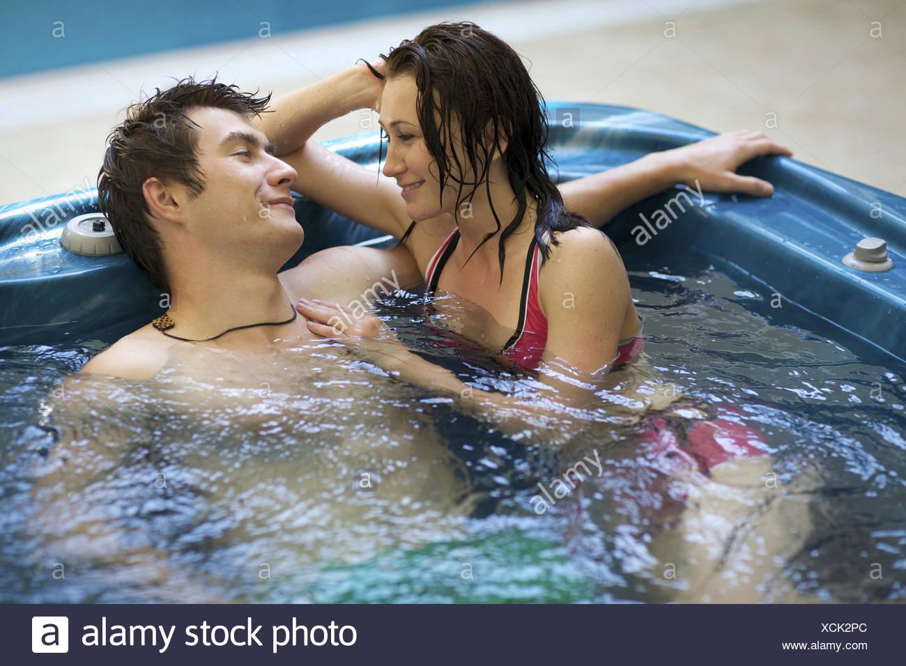 Couple bathing at jacuzzi - Stock Image