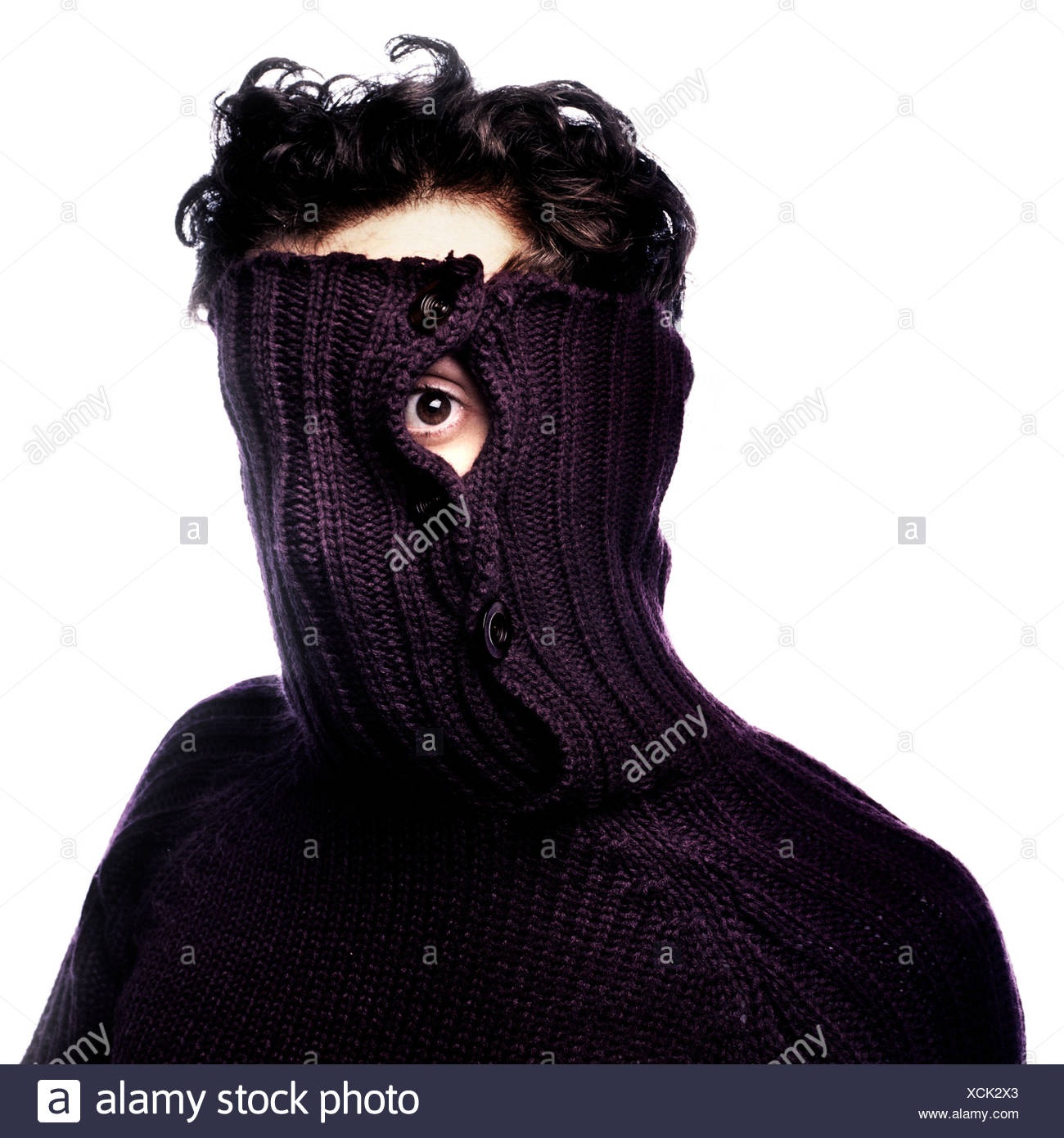 Portrait of man in oversize pullover - Stock Image