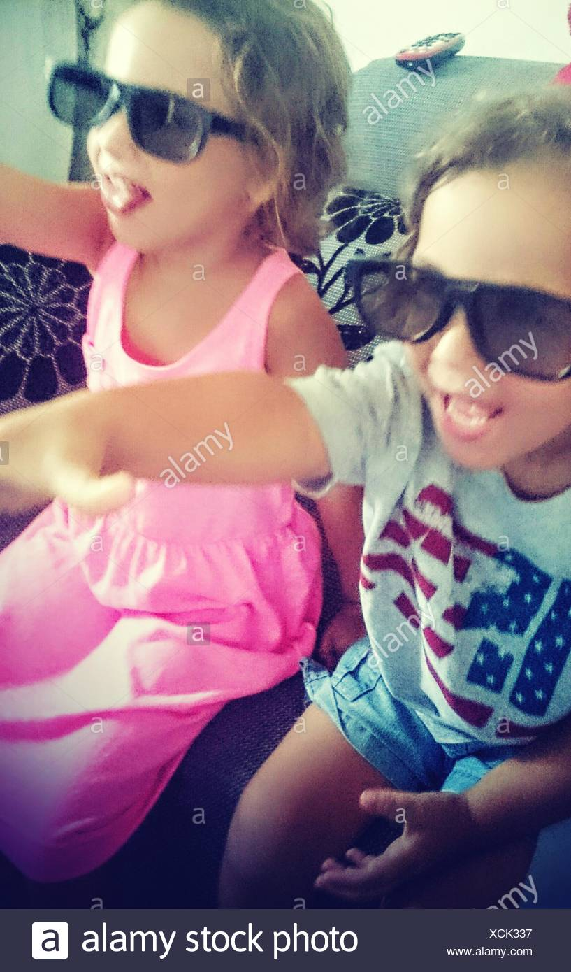 Boy And Girl With 3-D Glasses At Home - Stock Image
