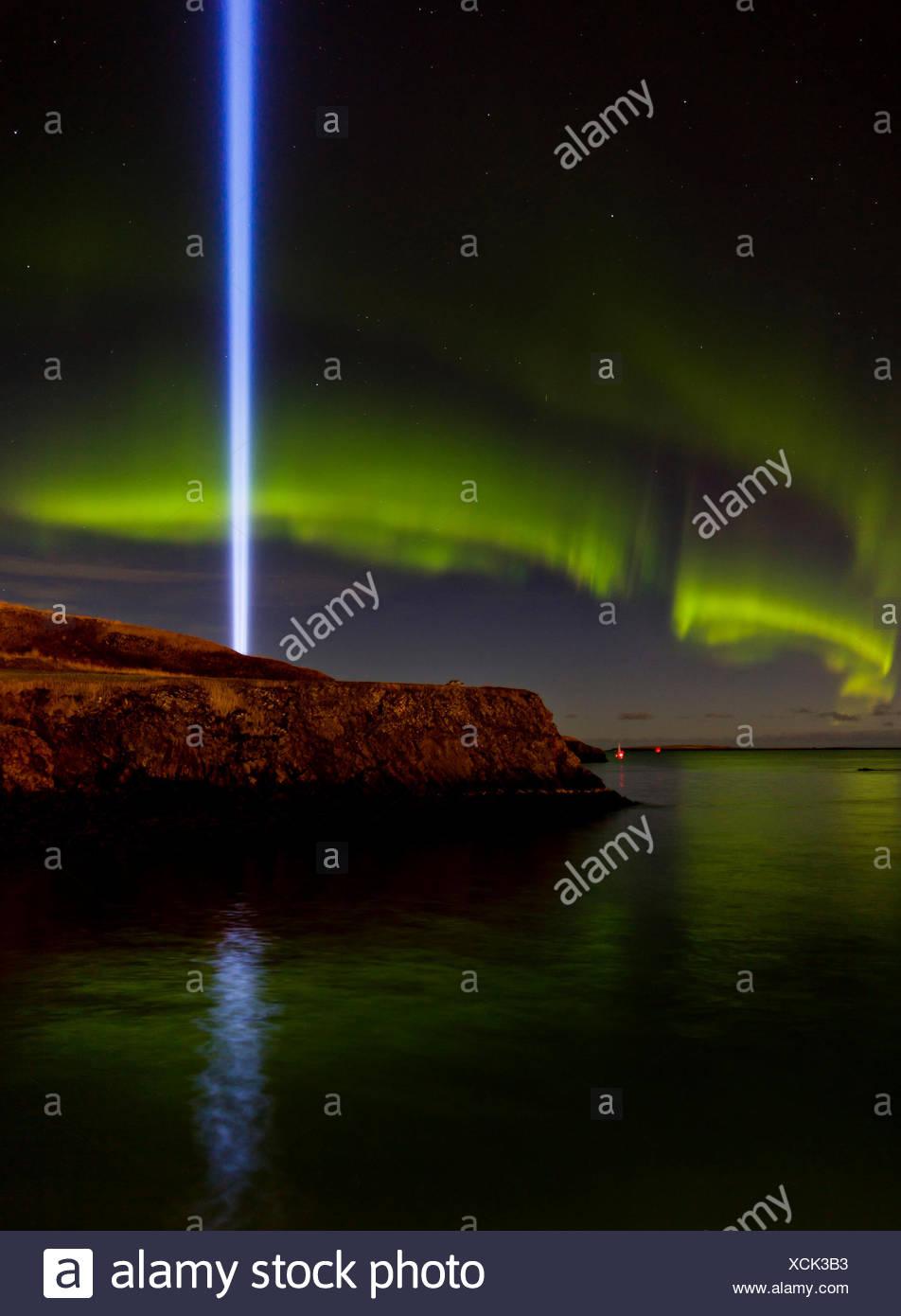 Beam of light from The Imagine Peace Tower and Aurora Borealis, Videy, Reykjavik, Iceland - Stock Image