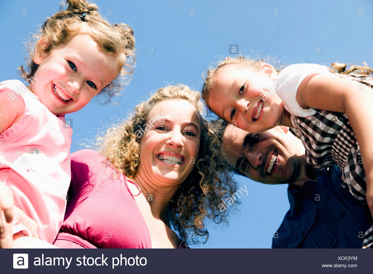 low angle portrait of family with two children - Stock Image