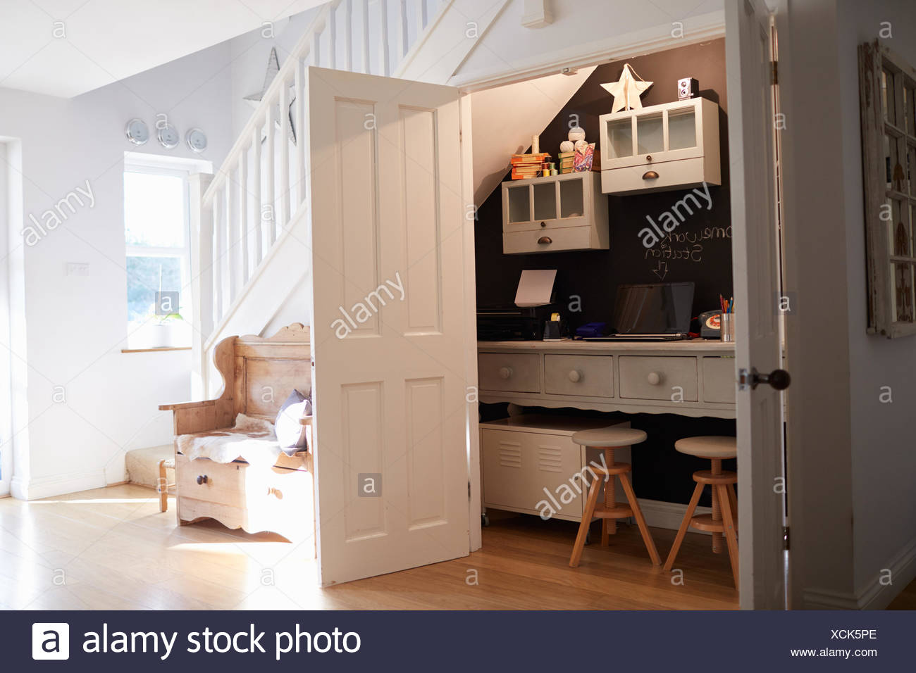 Under Stairs Home Office In Contemporary Family Home   Stock Image