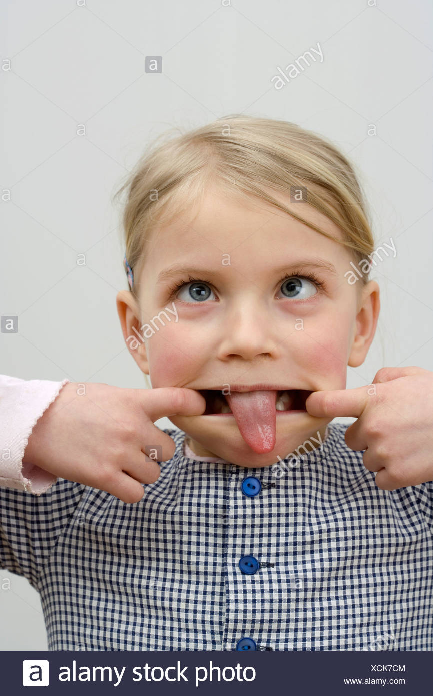 A little girl making a face - Stock Image