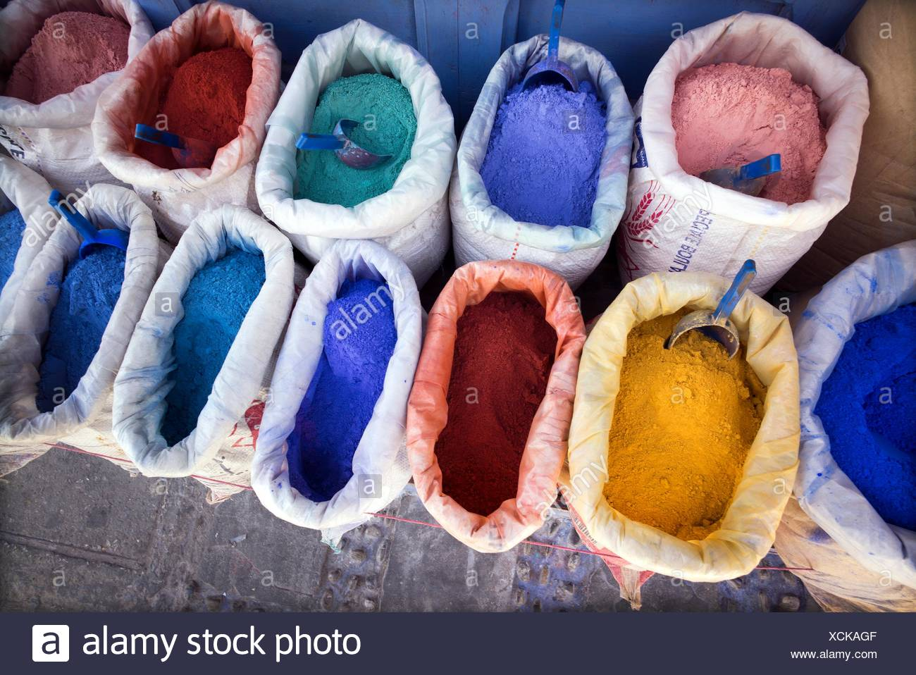 Sacks of dyes for dyeing lime and paint of different typical colors. Chaouen, Morocco - Stock Image