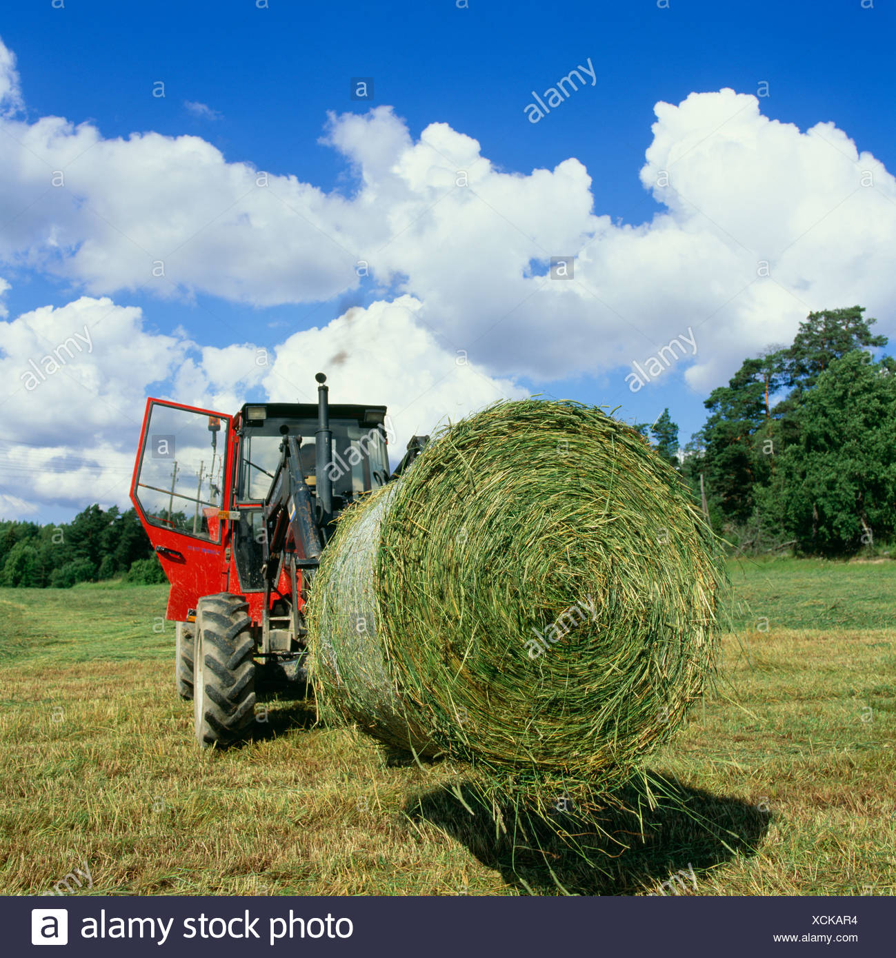 A tractor at a farm, Sweden. - Stock Image