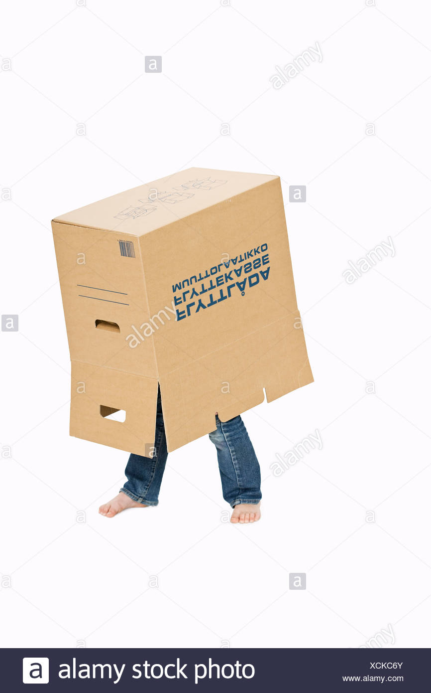 A girl standing in a box. - Stock Image