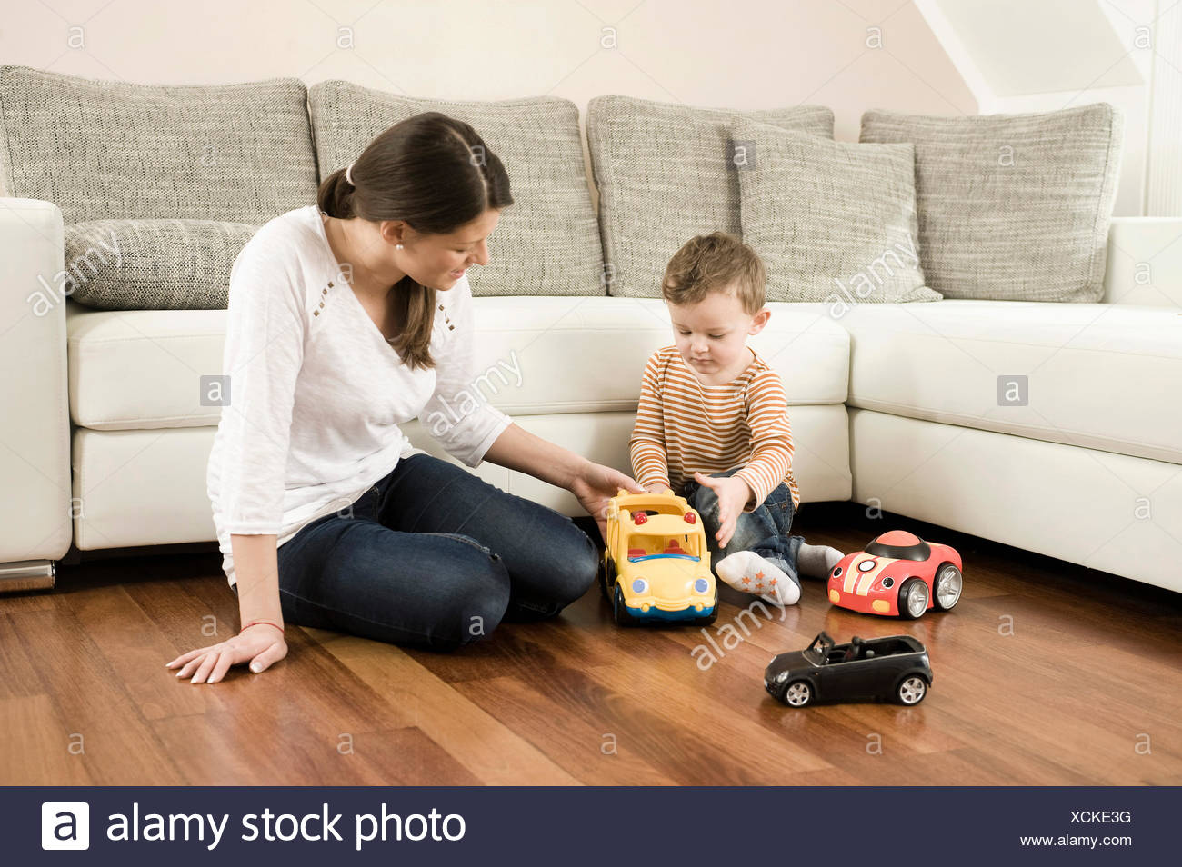 Mother and son playing with toys - Stock Image
