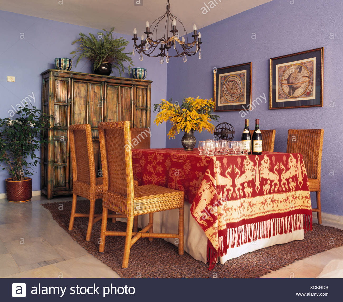 Opulent Red And Gold Cloth On Table In Blue Spanish Country Dining Room  With Wooden Chairs