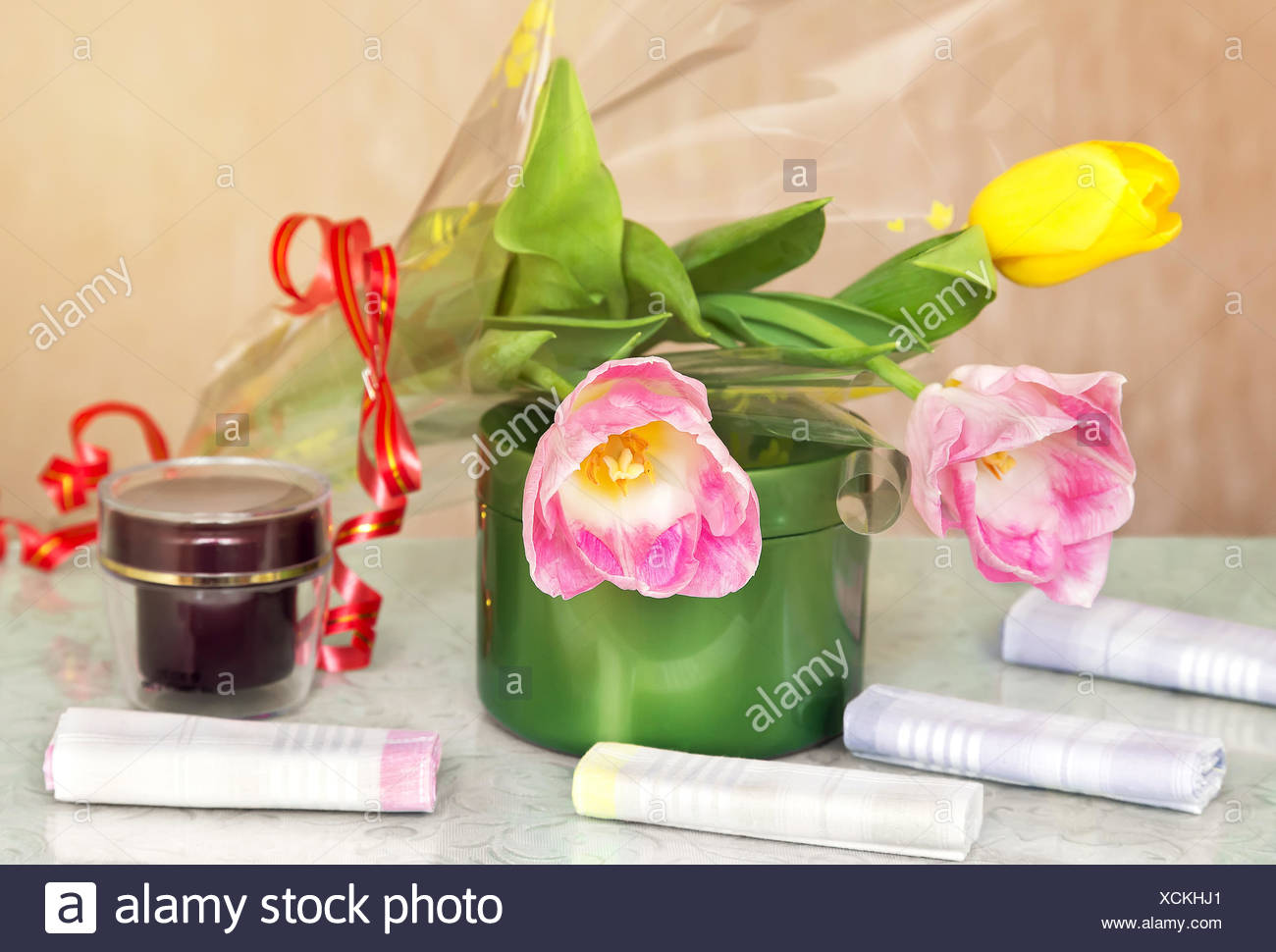 Cosmetics for body and hair and flowers. - Stock Image