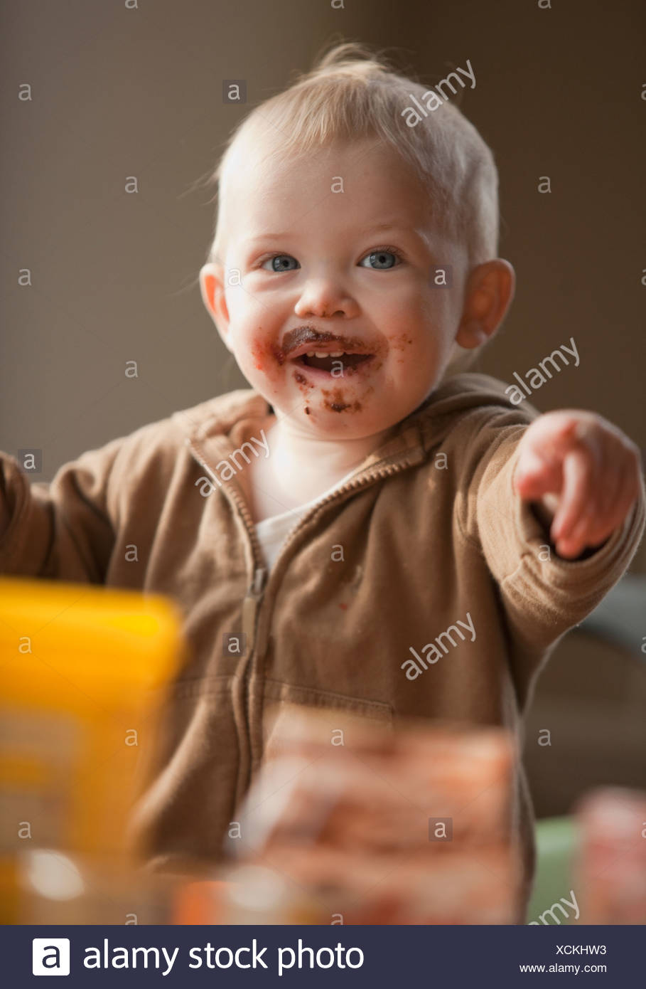 Baby with messy face - Stock Image