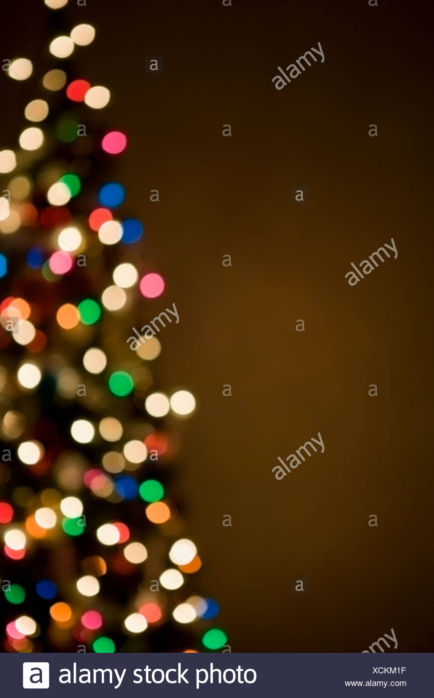 Christmas lights on tree, out of focus Stock Photo