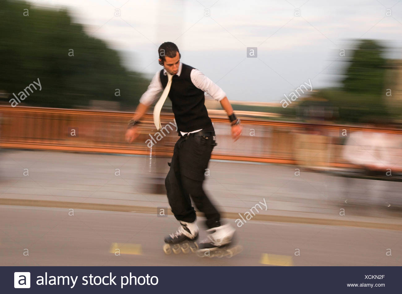 Skater with tie driving backwards through a slalom france paris skater with tie driving backwards through a slalom france paris ile de france ccuart Image collections