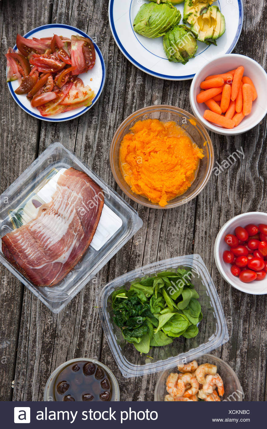 Selection of food on picnic table - Stock Image