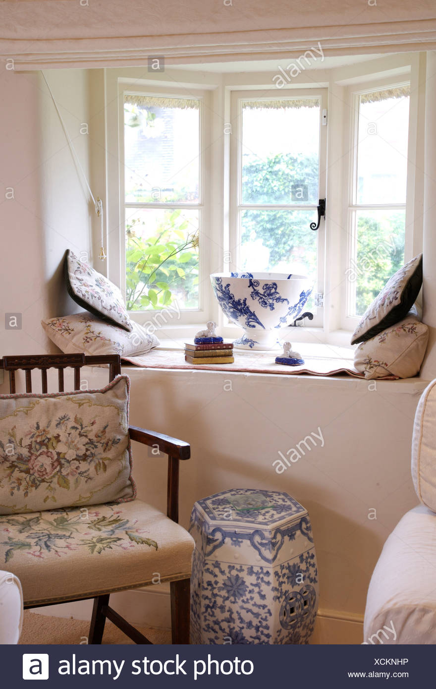 Hand Worked Tapestry Cushion And Seat On Wooden Chair Beside Chinese Blue White Porcelain Stool Below Cottage Window Stock Photo Alamy