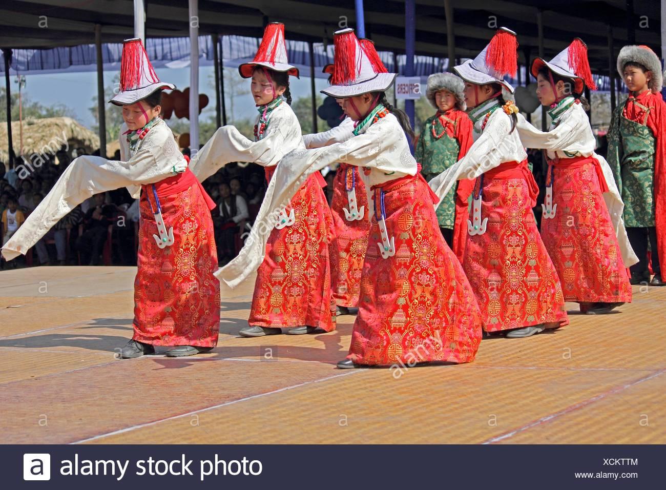 Tibetan performing folk sleeve dance traditional minority at Namdapha Eco Cultural Festival, Miao, Arunachal Pradesh, India - Stock Image
